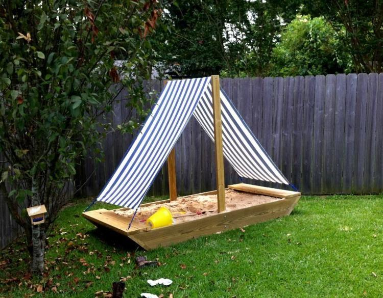 Verspieltes Sandkasten Design In Form Eines Segelboots | Garten ... Sandkasten Selber Bauen Ideen Tipps Garten Kinder Spiel