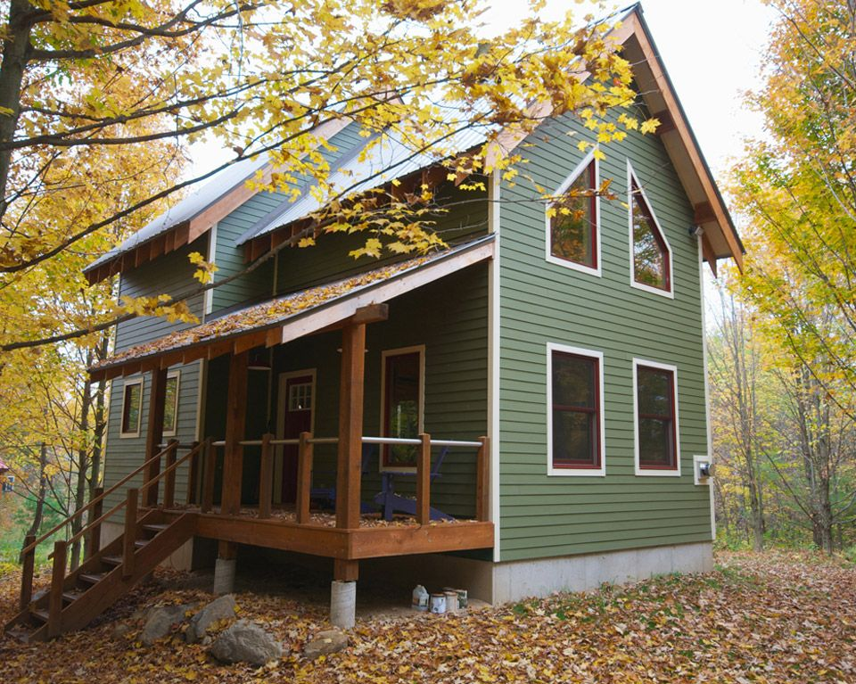 small green house in the woods to heck with the house - Two Story Tiny House