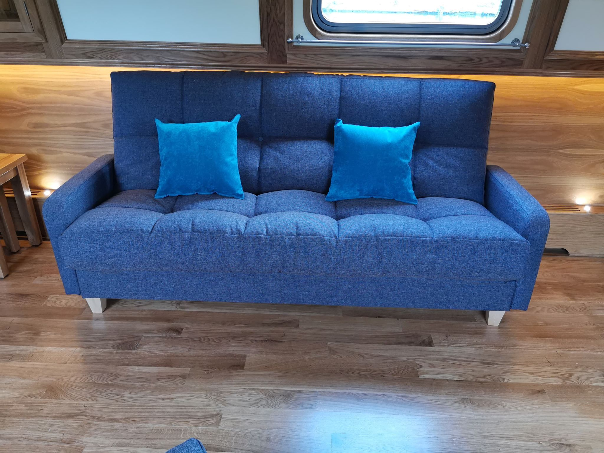 Large 3 seat sofa bed in a funky electric blue fabric