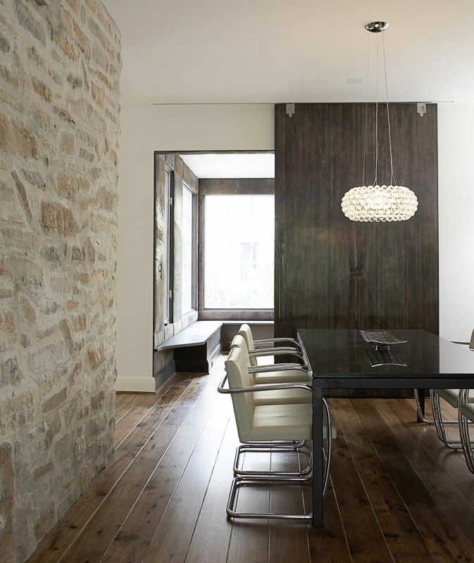 Blending Rustic And Modern Elements The Combination Of Stone Accent Wall Dark Wood Contemporary Dining RoomsDining