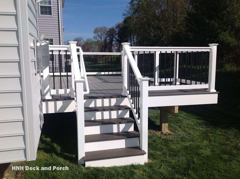 Vinyl Deck Using Wolfbuilding Seaside Collection Pvc Decking With Harbor Grey Flooring White Pvc Posts And Black Square Deck Steps Deck Colors Deck Railings