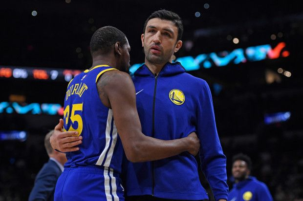 989c743228e Golden State Warriors  Zaza Pachulia (27) hugs teammate Kevin Durant (35)  before the start of Game 3 of their NBA first-round playoff series at AT T  Center ...