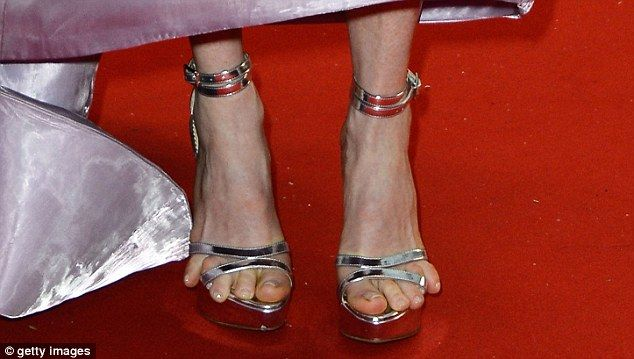 30237020b1 Feet need Moore room? Julianne's tortured toes are on full display ...