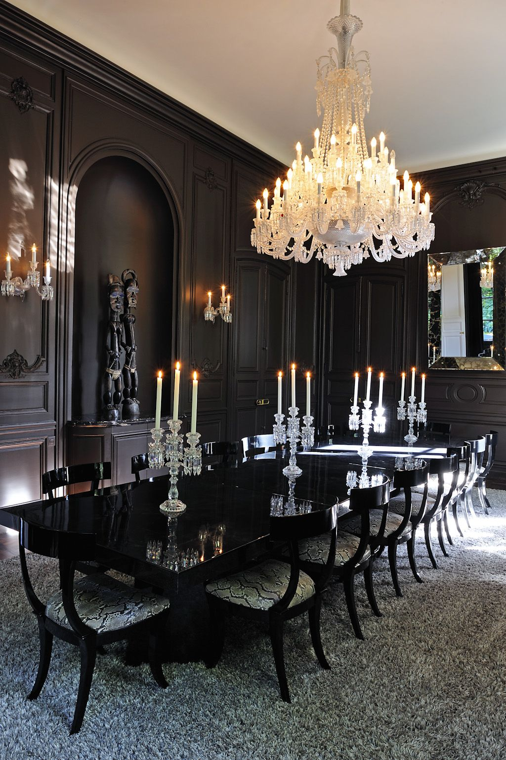 Black mystery and allure. Black lacquer wall panels, dining ...