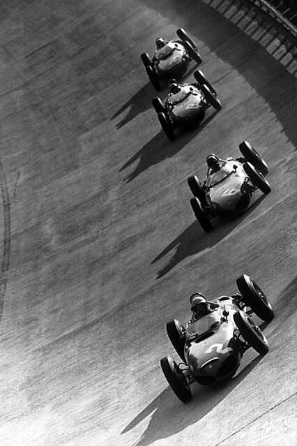 In the 1961 Italian GP, Enzo Ferrari had entered no less than five Ferrari 156 cars: Phil Hill, Richie Ginther, Ricardo Rodriguez and Giancarlo Baghetti all driving the dominant shark nose cars chase each other on the treacherous Monza banking. Missing is Wolfgang von Trips, driving the fith Ferrari, who was killed on the first lap. #ScuderiaFerrari #RedSeason