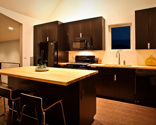 like our kitchen, but with lighter wood floors and ceiling. I'm thinking of adding tile backsplash to brighten it up
