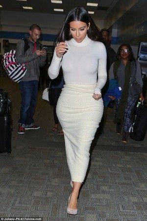Kim Kardashian wearing Saint Laurent Paris Suede Pump, J.W. Anderson Fall 2014 Skirt and Wolford Colorado String Bodysuit in White