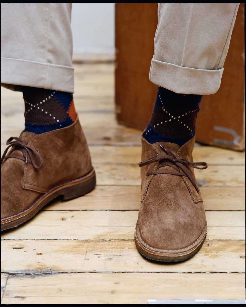 In a wearable navy fabric, the original Desert Boot from