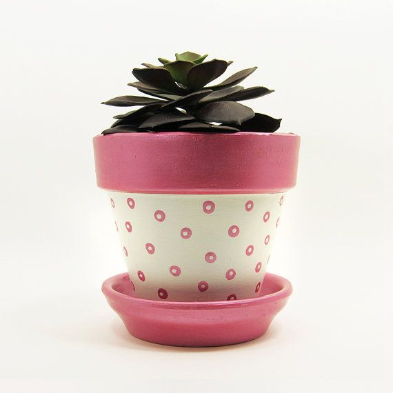 Add a cute touch to your home or office with this unique handpainted black terracotta pot with metallic pink rim and dots with matching saucer handmade by Timberline Studio. Perfect for small indoor plants such as air plants, succulents, or cacti (or a faux one, if you prefer). Looks beautiful in a sunny window. #pink #terracotta #planter #polkadot #succulents #succulent #homedecor #decor #modern #interiordesign #minimal