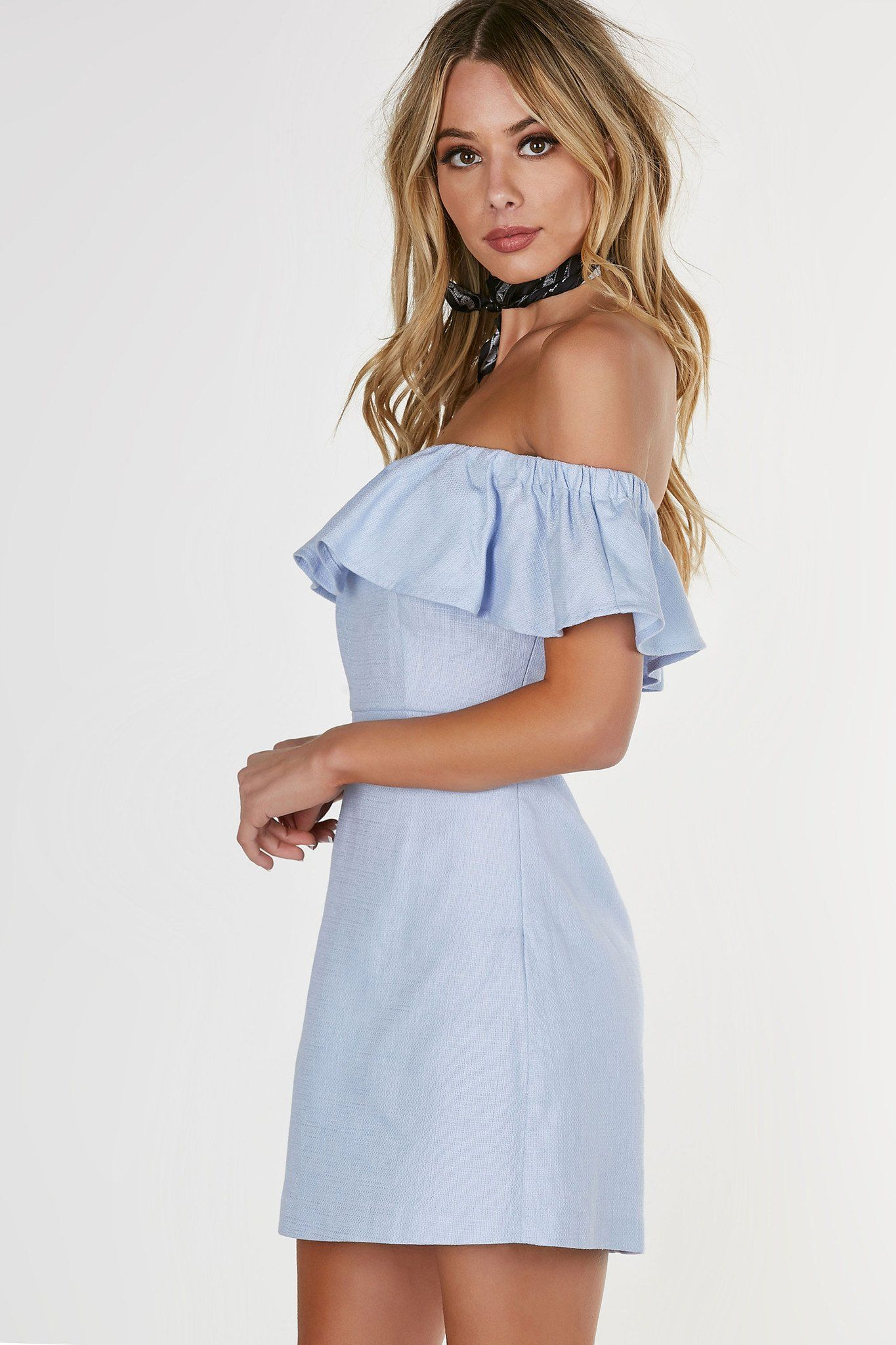 72f03fdf789c9 Structured tube style off shoulder dress with single ruffle tier at top for  added detail. A-line hem with hidden side zip closure.