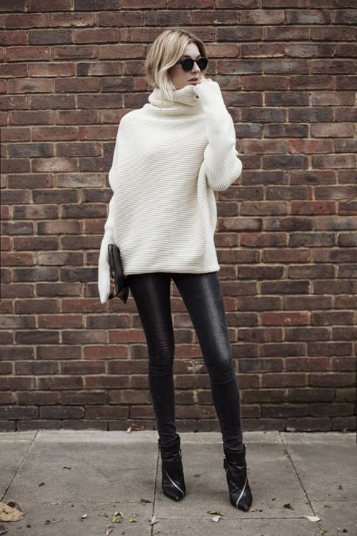 Boxy silhouette, white jumper, leather leggings, ankle boots.