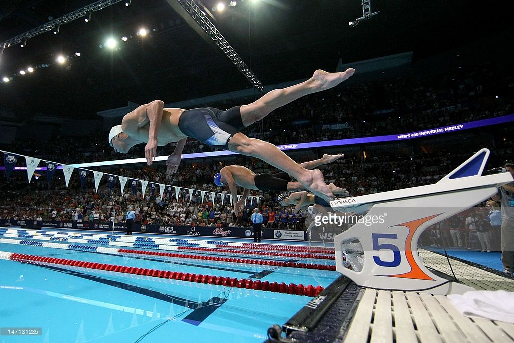 lochte dive off the starting blocks at the start of the championship final heat of the mens 400 m individual medely during the 2012 u olympic swimming