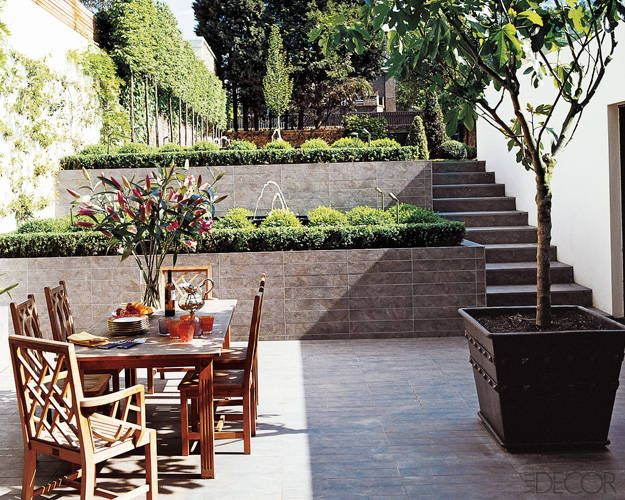 These are the perfect outdoor dining tables for your next for Garden area ideas