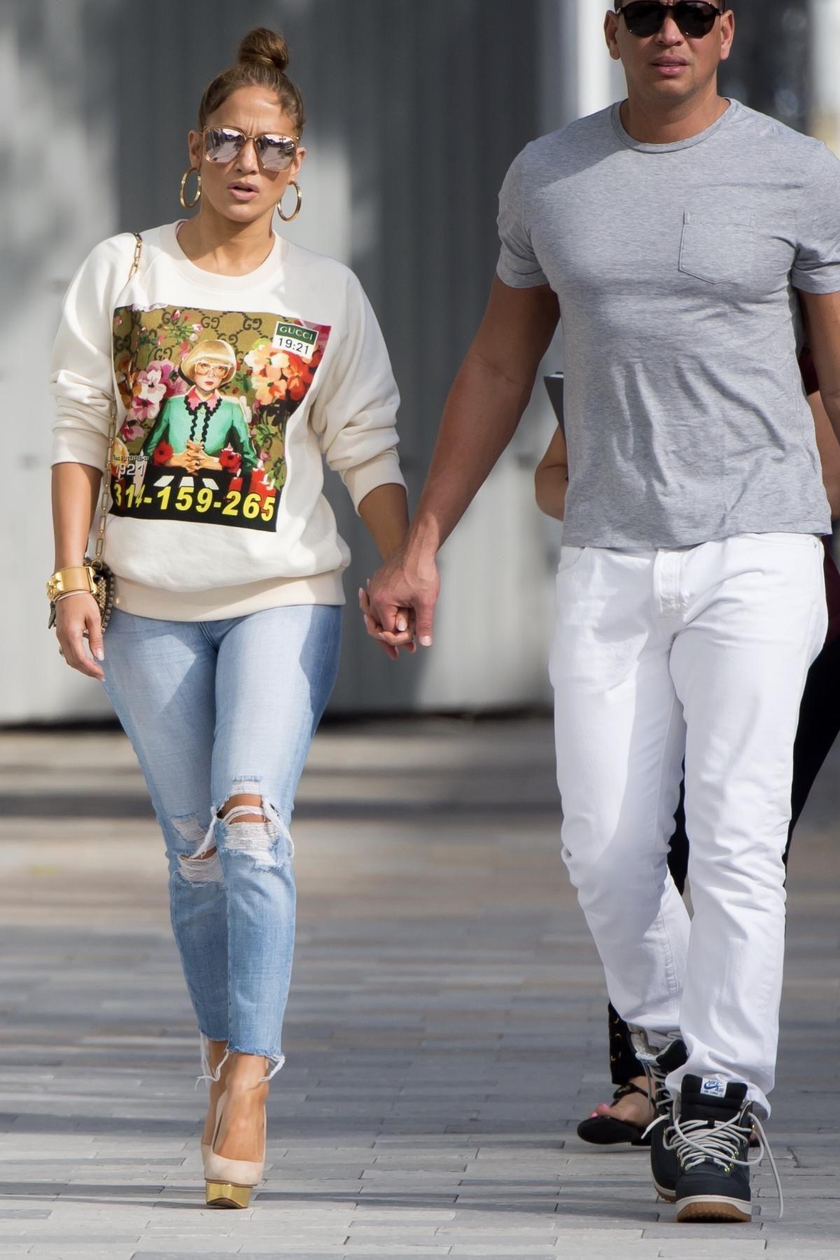 7629c7038f4 Jennifer Lopez wearing Charlotte Olympia Dolly Platform Pumps and Gucci  Ignasi Monreal Print Sweatshirt