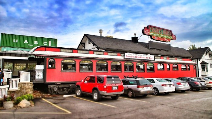 """A wooden """"palace"""" era car still in use as a diner today. Spokane WA."""