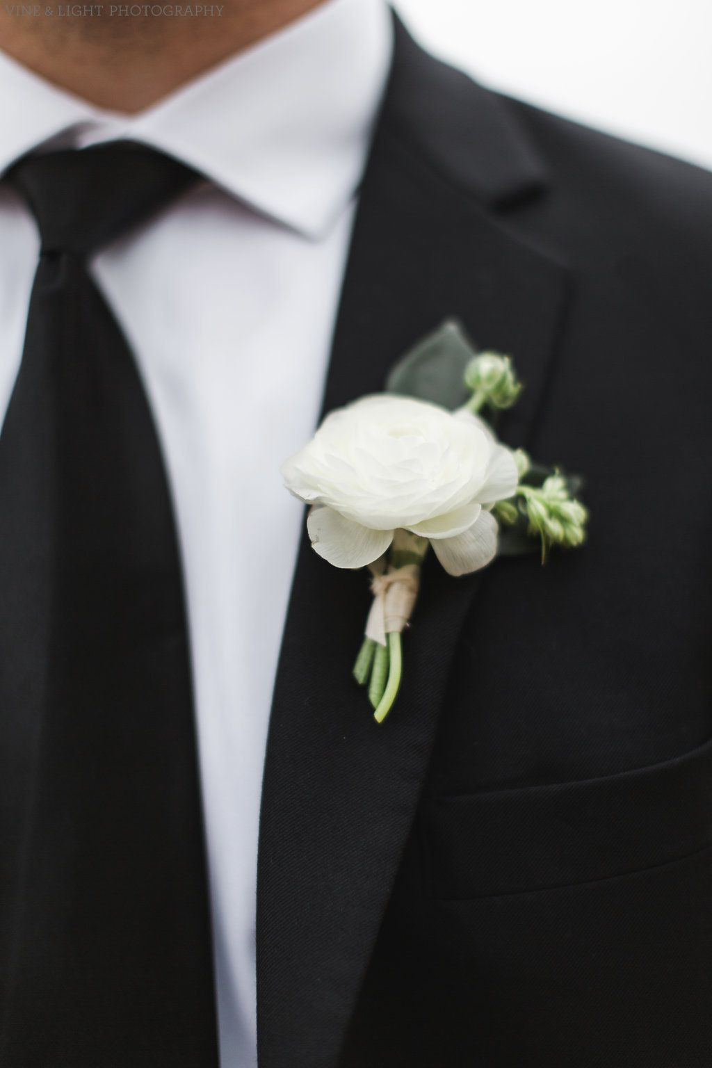 Classic Groom Boutonniere Of White Ranunculus And Larkspur Bud Ranunculus Boutonniere White Ranunculus Ranunculus