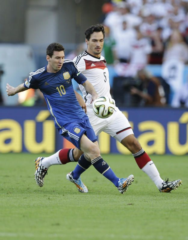 Argentina's Lionel Messi, left, and Germany's Mats Hummels go for the ball during the World Cup final soccer match between Germany and Argentina at the Maracana Stadium in Rio de Janeiro, Brazil, Sunday, July 13, 2014. (AP Photo/Victor R. Caivano)