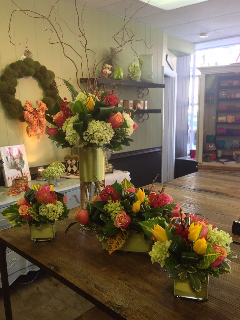 Bright fall flower arrangements with red protea macara orchids