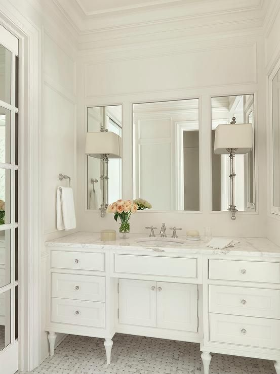 Elegant white bathroom features white walls accented with white ...
