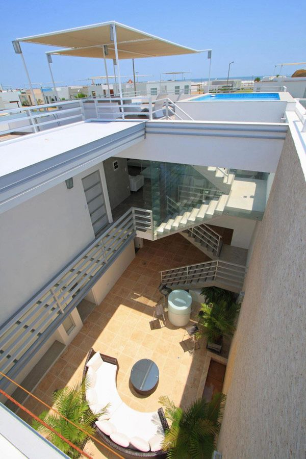 Dise o de interiores arquitectura casa de playa en per - Disenos interiores de casas ...