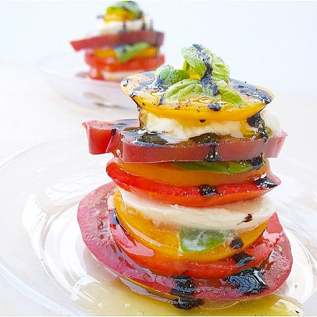 Heirloom tomato stack, with buffalo mozzarella, balsamic reduction and olive oil! Looks like a little basil aswell! Yuuuumy. Regram from @thekitchensinkblog #friendswithsalad