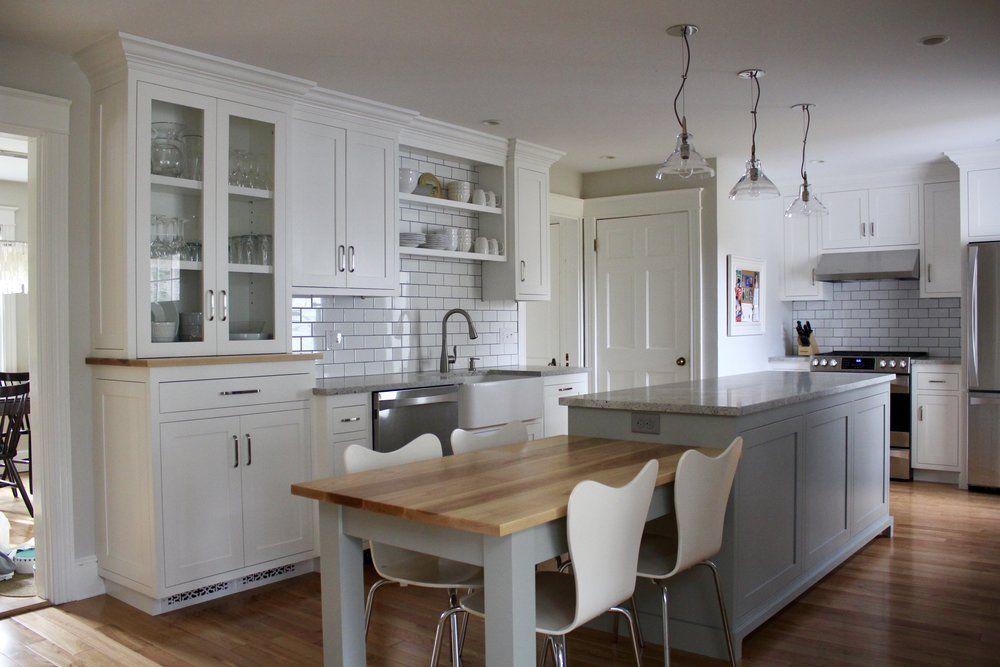 Snowfall White And Sea Haze (grey) Cabinets, Red Birch Flooring, Hickory  Tabletop, 3x6 Subway Tile Backsplash, Himalaya White Granite Countertops.