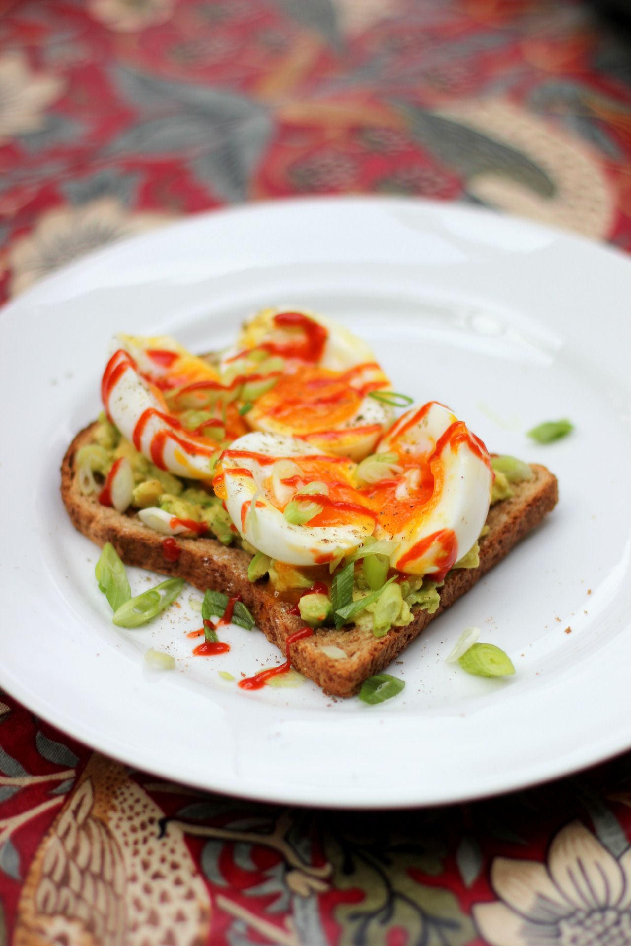 yum-yes-please:  it was supposed to be eggs and soldiers, but i got very carried away… toast, crushed lime avocado, soft-boiled egg, spring onions, a crack of black pepper, and sriracha sauce   *making me hungry*