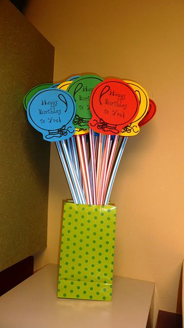 birthday gifts to give the students... big pixie sticks with balloons attached!