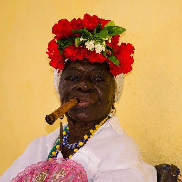 Quintessential Cuban travel image - Cigar smoking Cuban woman in Havana Vieja. #Cuba #Cuban #havanavieja #cigars #dkwpcuba by donnakayewilliams