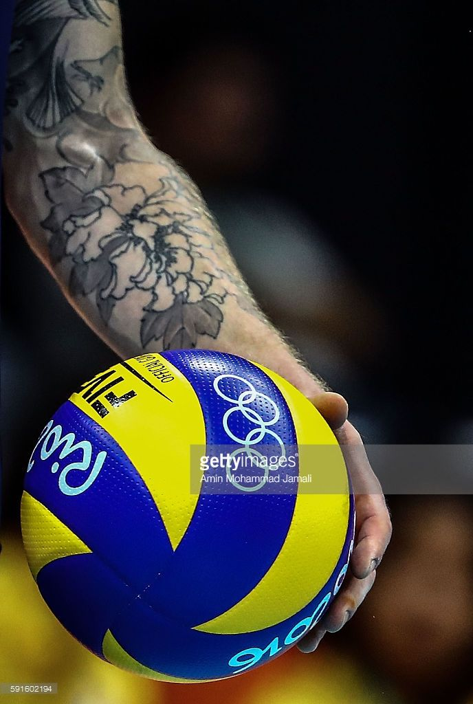 Ivan Zaytsev 9 Of Italy Holds A Ball Against Iran During The Men S Quarterfinal Volleyball Match On Volleyball Wallpaper Volleyball Photos Volleyball Pictures