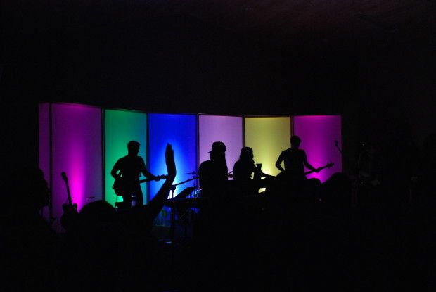 Band in a Box. Build six, 8′ X 4′ X 1′ boxes using 1 inch furring strips. Cover front and sides with clear sheets of Coroplast.  Cover back with white coroplast sheets to reflect light better. Use Elation Tri Opti 30 lights in each box.  You can program the lights to music using Light Jockey.