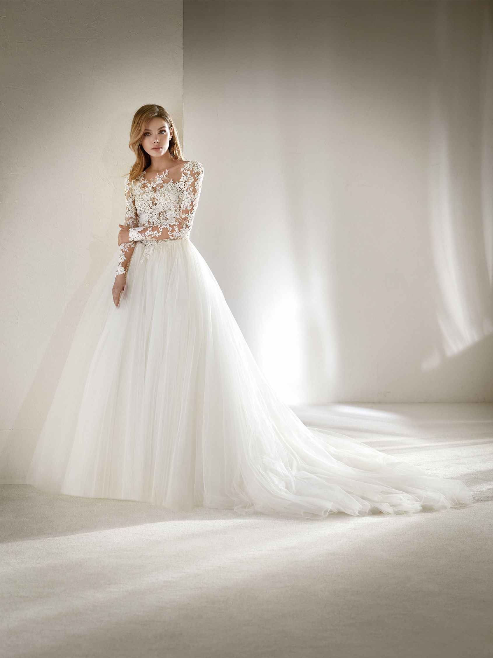Spectacular ballgown wedding dress with a two-piece effect in