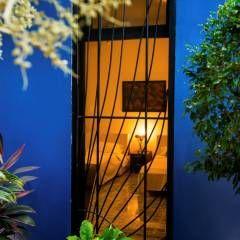 Patio Azul - Recámara de Huespedes: Puertas y ventanas de estilo moderno por Taller Estilo Arquitectura