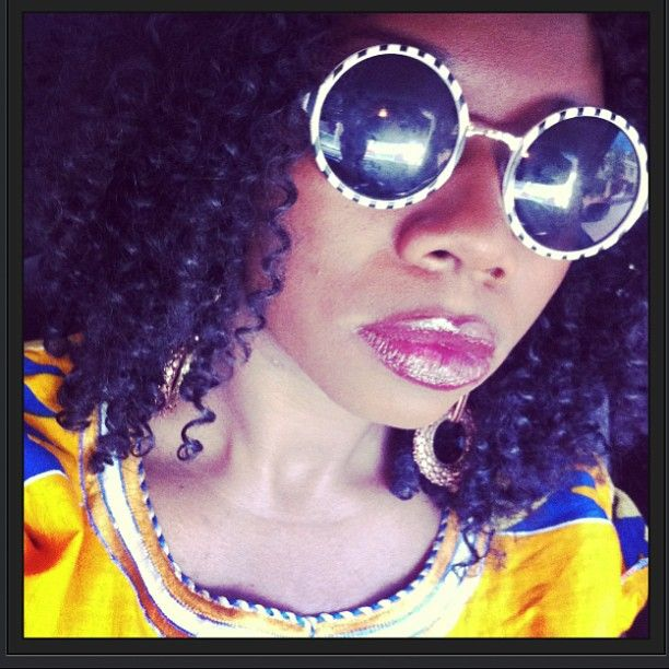 The natural hair movement and fashion! This is my sister rocking a Dashiki wearing Film Noir lipstick by MAC, and finished off with very fly eye gear from Aldo!