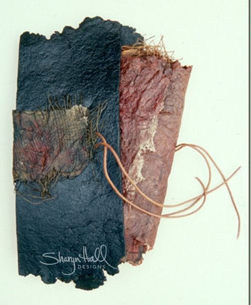Sharyn Hall Designs (Australia): 15cm x 30cm 1993 Loose Pages and book cover Handmade fibre papers, artist's papers, dyed silk organza, found objects, threads, photographs, gesso, paint and graphite. Exhibited: Artists Book Fair, State Library, Brisbane; Signs, Symbols, Scrolls, Fusions Gallery, Brisbane; Paper, Queensland Museum Aquired: Public Spaces Art, Mirvac Constructions</p>