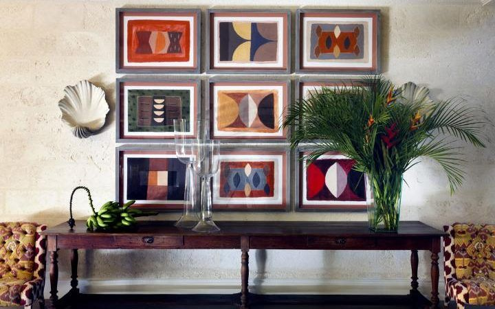 Above A Long 19th Century Fruitwood Console Table Hangs A Series Of  Artworks By Breon Ou0027Casey (breon Ocasey.co.uk). The Shell Sconces Are By  Porta Romana ...