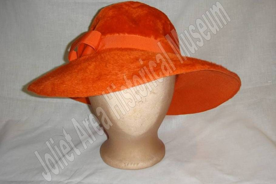 Orange felt hat with ribbon.. Make it a little more red and I d say Carmen  Sandiego donated her signature accessory! 924693a26ecd