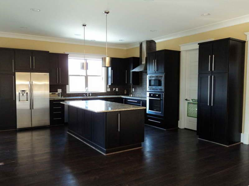 Dark hardwood floors for classy and elegant design with a for Dark cabinet kitchen ideas