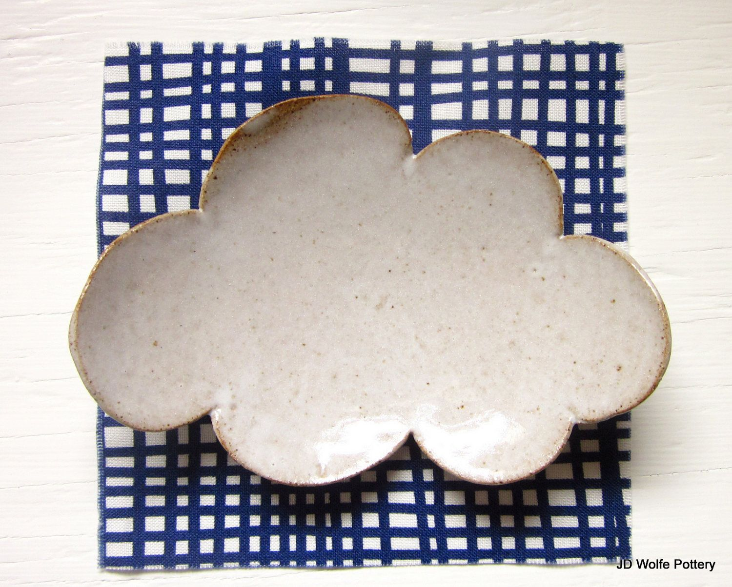 This white cloud teaspoon rest would make a charming tray to hold small pieces of jewelry.
