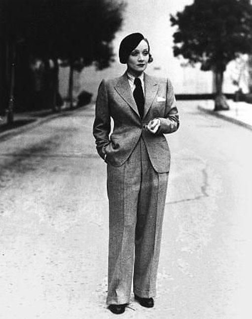 Marlene Dietrich in the 1930's. The most famous aspect of Marlene's style is her penchant for menswear. She wore masculine three-piece suits to create a distinctly androgynous look that helped to revolutionize and redefine women's fashion. In fact, during the 1930s, she (along with Katharine Hepburn) helped to popularize and make pants acceptable for women to wear. Thanks, gals!