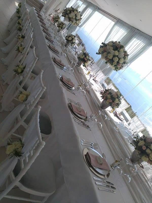Rectangular tables setting. Santorini Weddings, Wedding venue, Wedding ceremony and reception, Sunset view, lecielsantorini, Santorini, wedding, weddingphotography, loveisintheair, weddingplanner, santorinigreece, weddinginsantorini, weddinginspiration, destinationwedding, love, bride, weddingday, groom, brideandgroom, weddingdress, santorinivenues, Imerovigli, sunset, emotions, storyteller, couple.