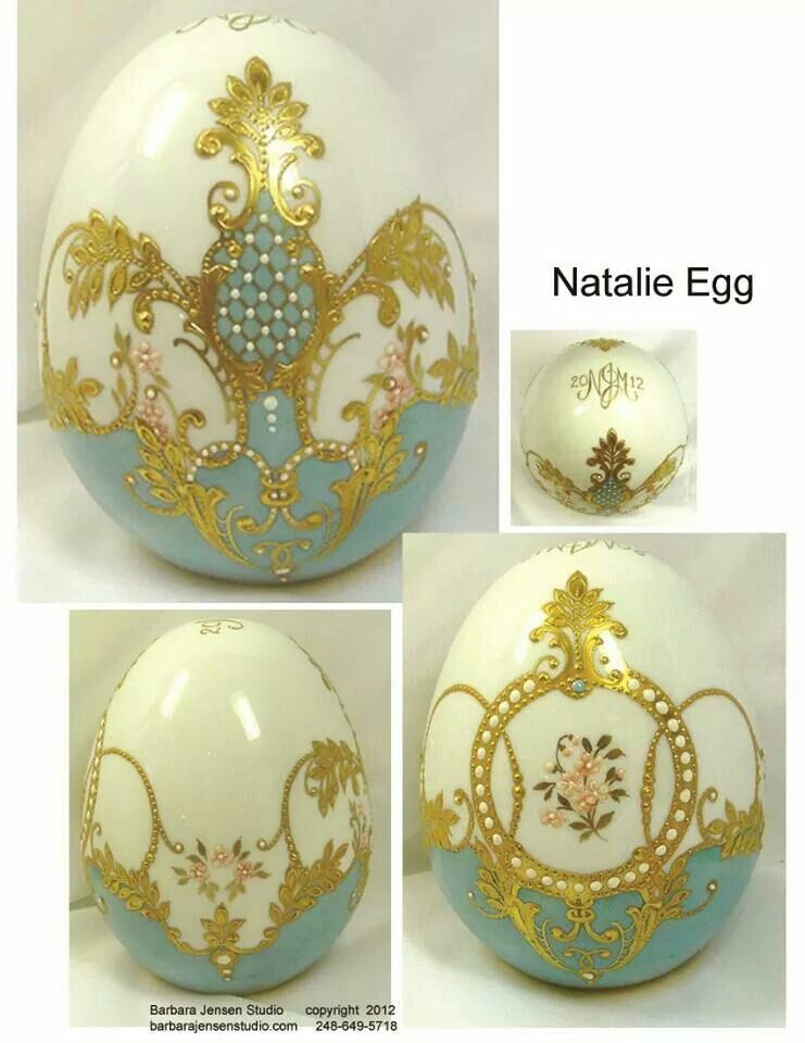 Barbara Jensen's blue and white egg.Lovely relief  and gold work. .
