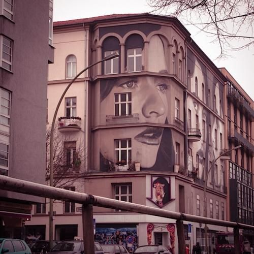Urban art continues to storm through the streets of bustling cities. This time it's Berlin and Melborune-based artist Rone has embellished large storey buildings with exqusite murals of a womans faces.