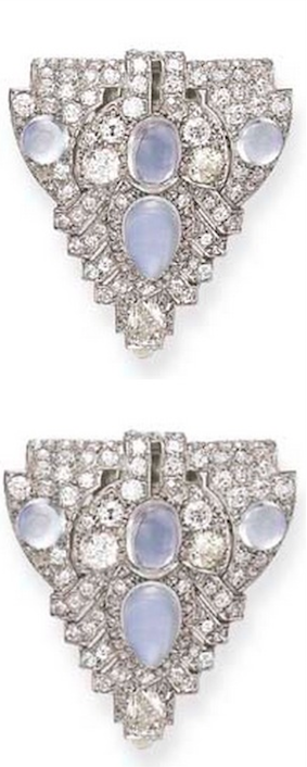 *A PAIR OF ART DECO DIAMOND AND MOONSTONE CLIP BROOCHES Each of openwork shield-shaped design, set with old European and pear-shaped diamonds, enhanced by cabochon moonstones, mounted in platinum and 18k white gold, circa 1930, with French assay mark and maker's mark