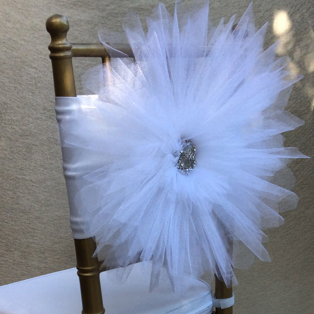 tulle chair covers for wedding cover hire gillingham white decoration with beautiful silver brooch