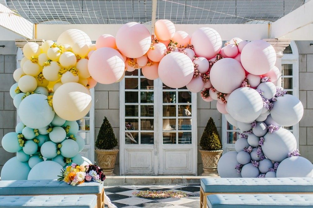 Rainbow balloon arch wedding at Campbell Point House