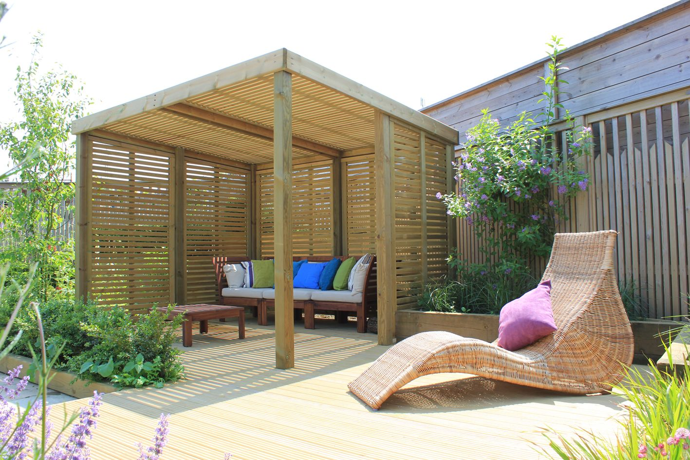 a decked area with the retreat shelter Deck with pergola