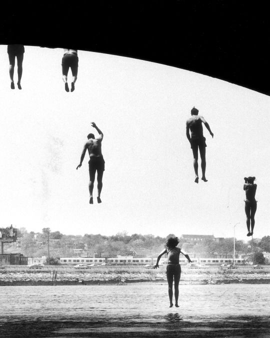 John Tlumacki: Kids cooling off on a hot day by jumping from Dorchester Bay Bridge, Boston, 1985