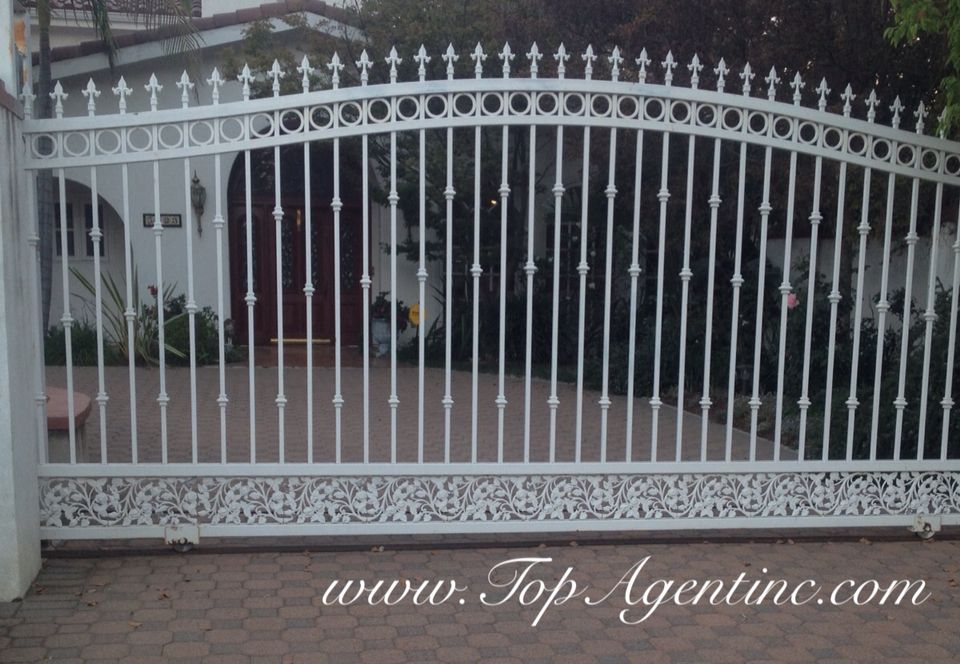 Floral Pattern Boarder On White Wrought Rod Iron Driveway Gate