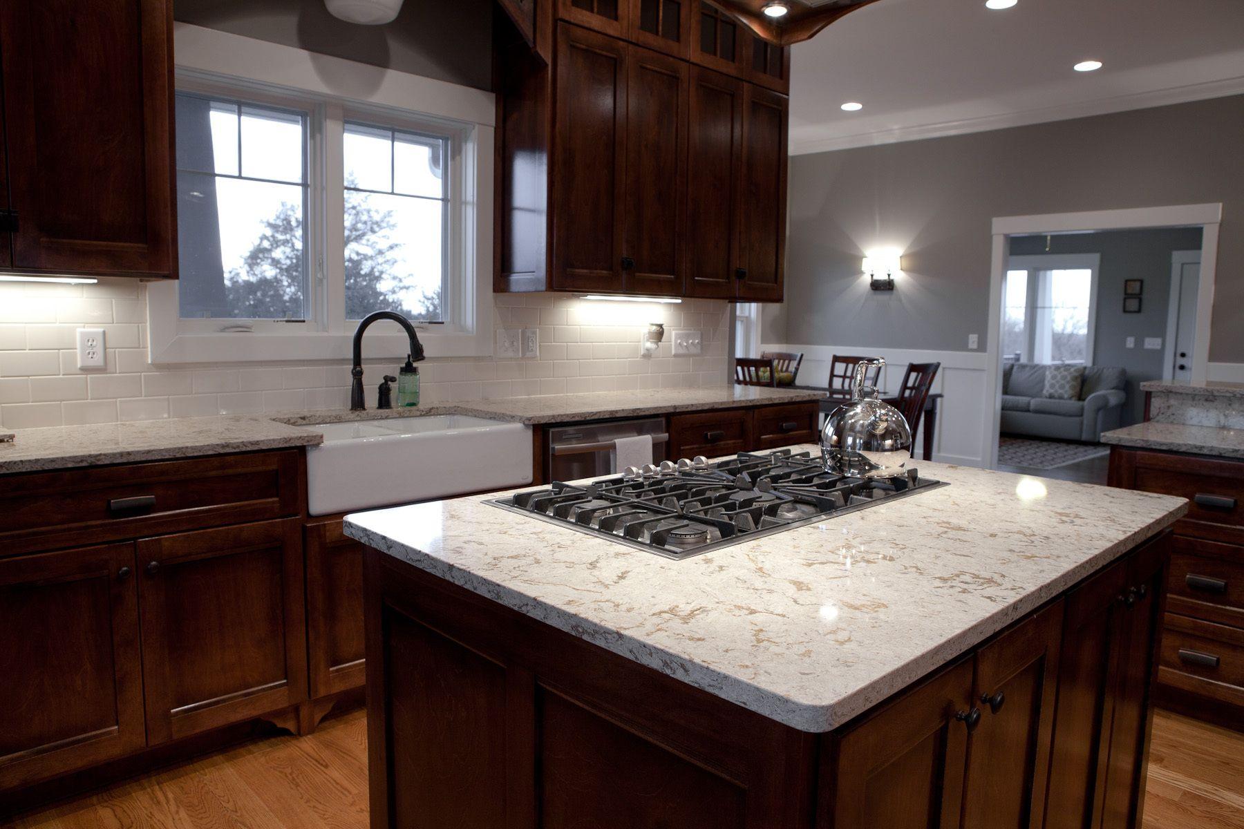 Classy Black Gas Stove Top On White Cambria Quartz Granite